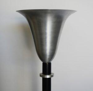 Spun aluminum lamp shade.