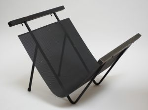 mid century modernist iron magazine rack