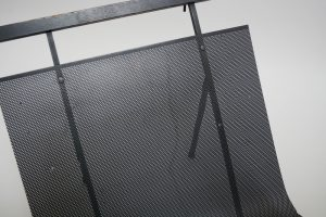 mid century iron magazine rack with perforated metal