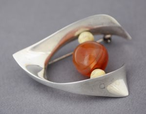Ronald Hayes Pearson sterling pin with carnelian and bone.