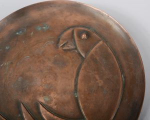 Rebajes copper plaque with art deco parrot