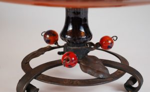 Base detail of Charles Schneider glass and wrought iron compote.