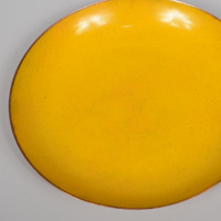 Large yellow enamel on copper bowl by Jade Snow Wong